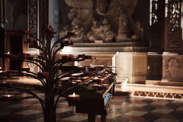 Verona, Italy, September 14, 2018 - Burning candles in the church of Verona