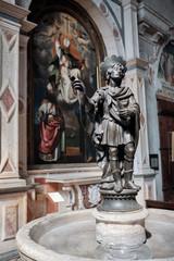 Verona, Italy, September 14, 2018 - Statue of a saint in the church of Verona