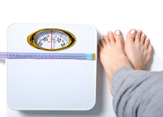 Female feet weighing scale centimeter on a white background isolation