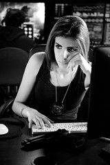 Cool strong female police woman studying hacker code black and white medium shot