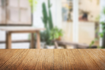 empty wooden table with blur restaurant background