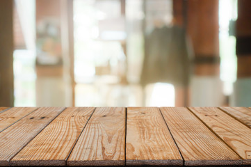 empty wooden table with blur coffee cafe background.