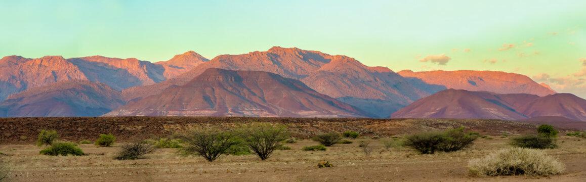 Brandberg Mountain in Namib desert early morning with rising sun, sunrise landscape, Namibia, Africa wilderness