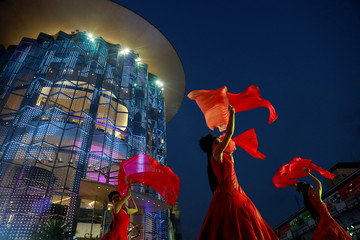 Artists perform at a shopping centre during the New Year festival in Bangkok