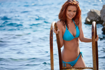 Bikini girl on the beach. Young beautiful woman in bikini on the beach on Adriatic Sea