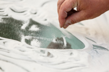 Sand animation. Hands draw sand
