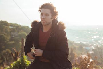 Portrait of dark-haired boy with curly hair in gazebo