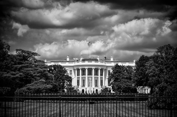 Dark and foreboding monochrome view of the White House with storm clouds brewing above the South Lawn in Washington DC, USA Wall mural
