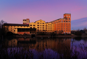 30 december 2018, Silea (north Italy): The old Toso Mill at sunset. The old buildings of the industrial mill on the river Sile (north Italy) damaged by fire in 2015.