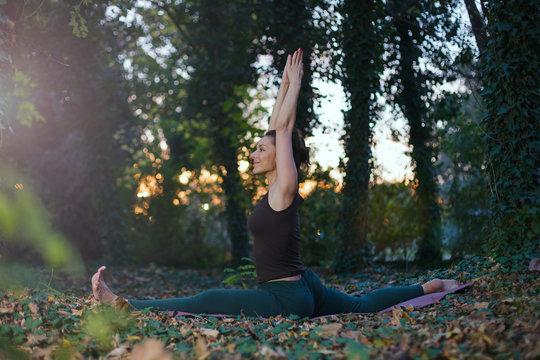 young woman doing monkey yoga pose
