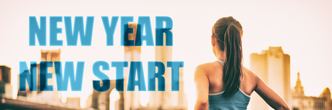 New Year 2019 resolution new start hope woman. New Year New Start healthy woman from behind looking away at city sunset sun flare in serenity. Panoramic banner. Looking ahead at her future goals.
