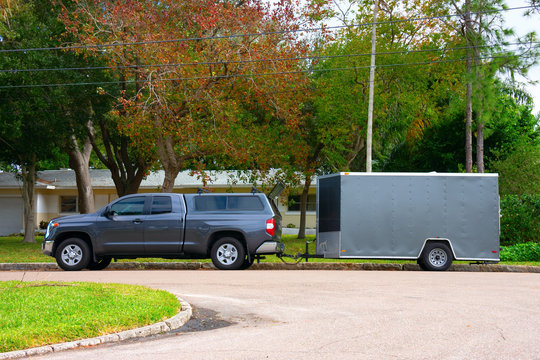 Heavy duty residential work truck with a trailer for lawn maintenance and construction.