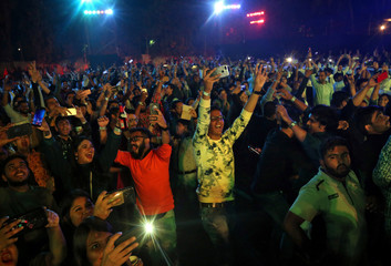 People dance as they celebrate the New Year's countdown event in Mumbai