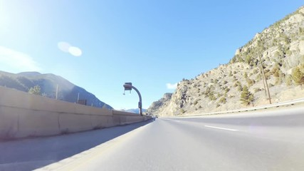 Wall Mural - Driving West on interstate highway I70 through the mountains.