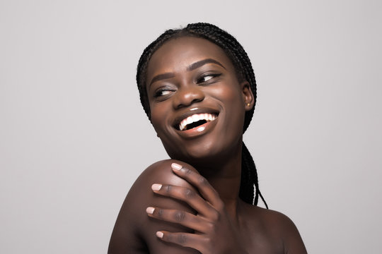 Pretty young afro american woman skincare face enjoying treatment isolated on white background