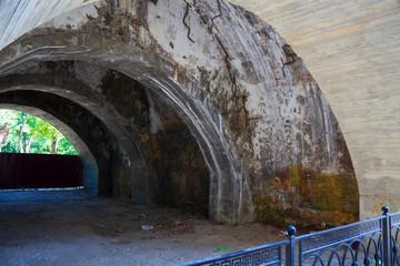 Cracked concrete arch, bridge support