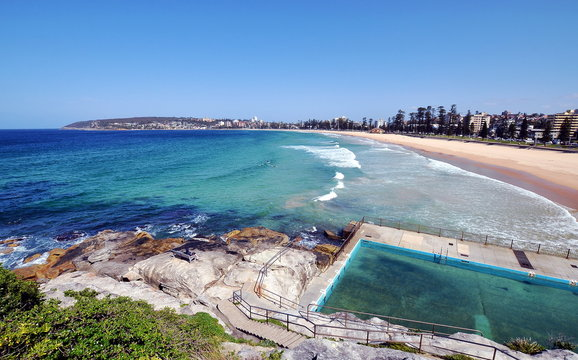 Ocean swimming pool with a view on beautiful empty Manly beach, Sydney, Australia