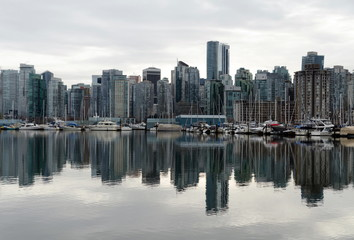 Looking at West Vancouver skyline from Stanley Park  across calm surface of Burrard inlet