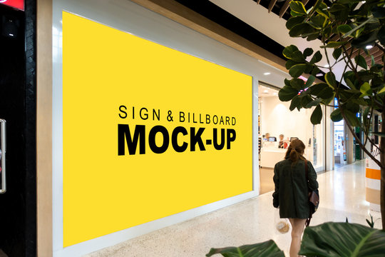 Mock up large billboard at front of showroom in mall