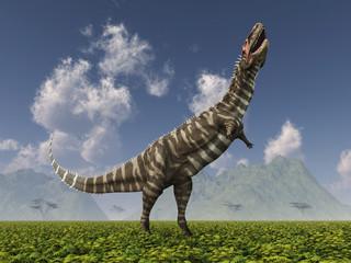 Dinosaurier Rajasaurus in einer Landschaft
