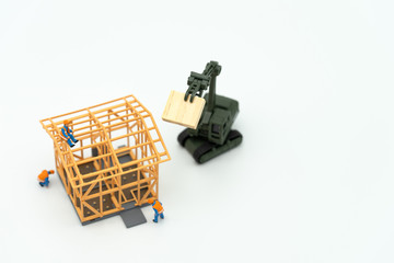 Miniature people Construction worker repair A model house model  using as background real estate concept and repair concept with copy space for your text or design.