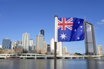 Spoed Foto op Canvas Oceanië The Australian flag against Brisbane city Queensland Australia