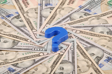 Question mark on mandala kaleidoscope from money.
