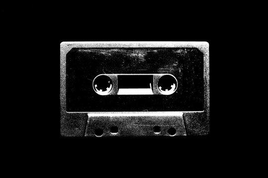 Audio cassette illustration on black background for design.