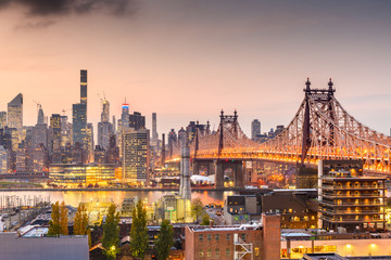 New York, New York, USA Manhattan skyline with the Queensboro Bridge.