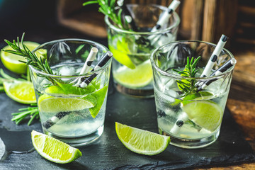 Fresh cocktail with lime, ice and rosemary, mojito cocktail