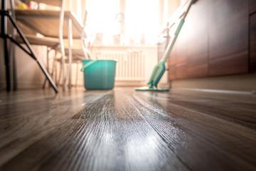 Wiping floor by wiper mop