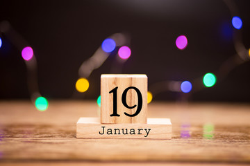 January 19th. Day 19 of month, calendar on wooden background. Winter time, year concept