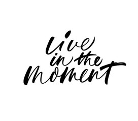 Live in the moment phrase. Vector modern calligraphy.