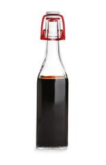 Bottle with balsamic vinegar on white background