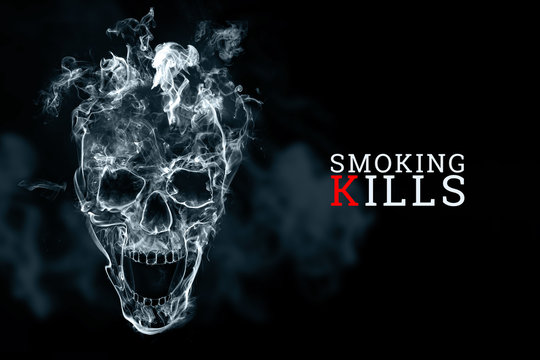 Skull from cigarette smoke on a black background. The inscription smoking kills. Creative background. The concept of smoking kills, nicatine poisons, cancer from smoking, stop smoking. Copy space.