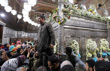 Egyptian Sufi Muslims pray at the shrine of Prophet Mohammed's grandson Hussein ibn Ali at the Al-Hussein mosque in old Cairo
