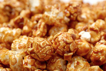 Sweet tasty caramel popcorn as background, closeup