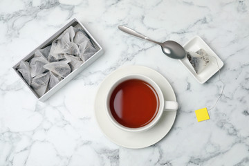 Flat lay composition with delicious hot tea on marble background