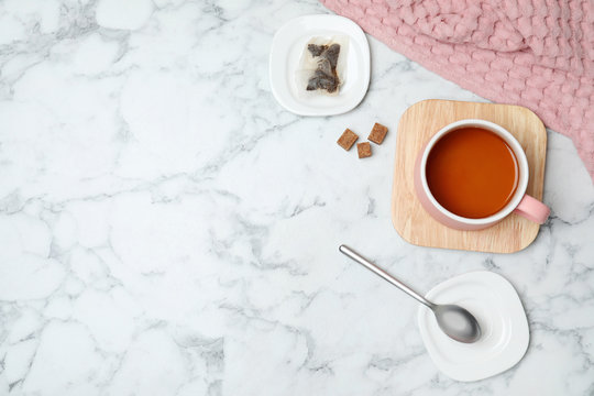 Flat lay composition with delicious hot tea and space for text on marble background