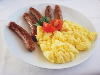 Fried sausages with scrambled eggs