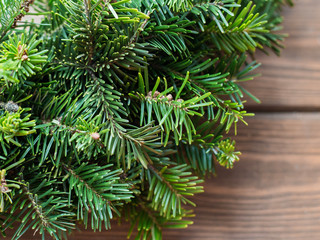 Fir-Tree branch on rustic wooden background used for christmas decoration