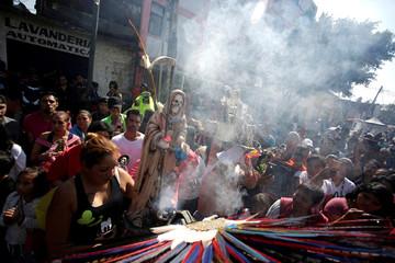 Followers carry sculptures of La Santa Muerte (The Saint of Death), a cult figure often depicted as a skeletal grim reaper, in Tepito neighbourhood