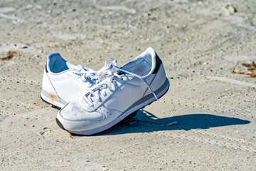 Tennis shoes left on the beach