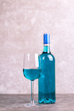 Glass and bottle of trendy blue wine. Spanish blue wine