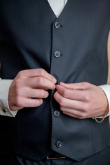 morning cooking, beautiful groom, dressed and preparing for a wedding, snap buttons jacket