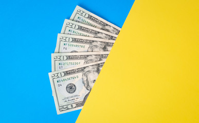 Cash Money on colorful background