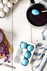 Naturally coloring Easter eggs with red cabbage. Homemade decoration eggs natural way.