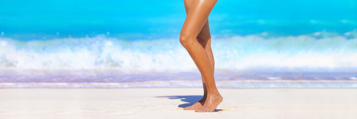 Smooth sun tanned slim legs standing walking on beach ocean banner header- Beauty spa salon background for waxing depilation laser treatment skincare for women.