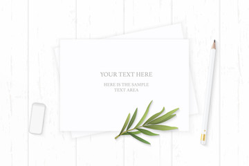 Flat lay top view elegant white composition paper pencil tarragon leaf and eraser on wooden background