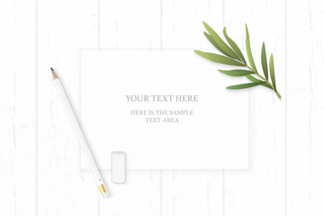 Flat lay top view elegant white composition paper pencil eraser and tarragon leaf on wooden background